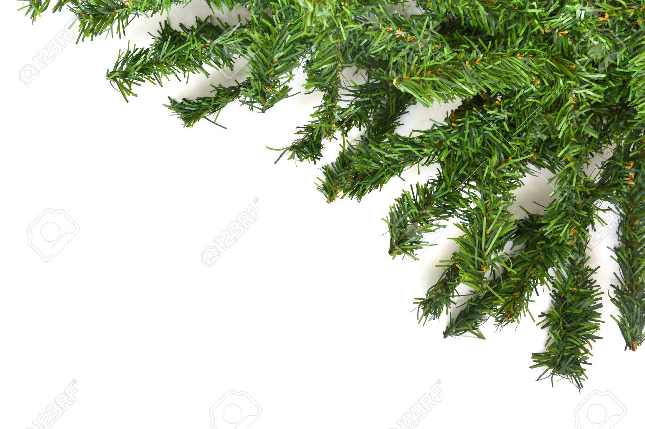 Artificial Christmas Tree Branches.Branches Of Artificial Christmas Tree Border On White Background