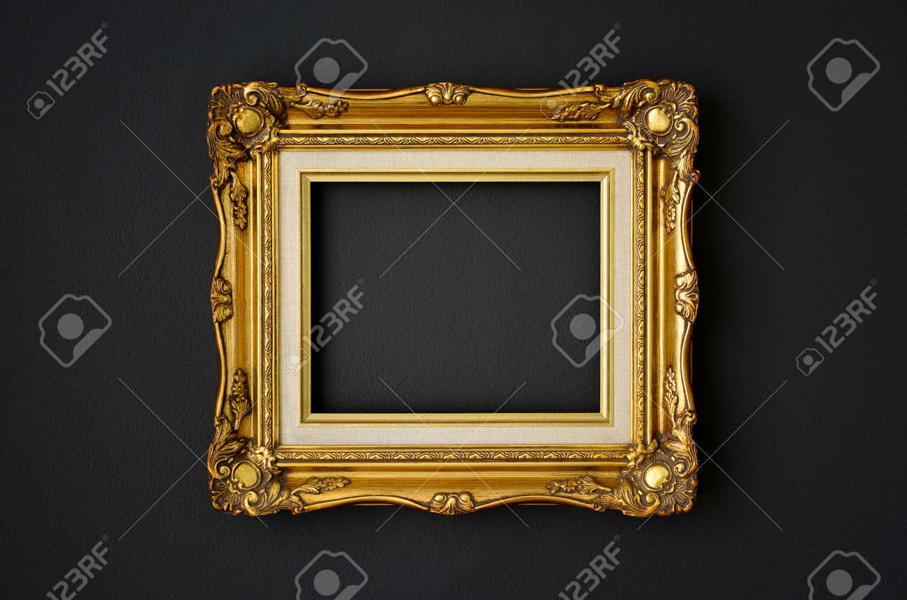 gold vintage picture frame on black color wall background, copy space, funeral and mourning concept - 143690846
