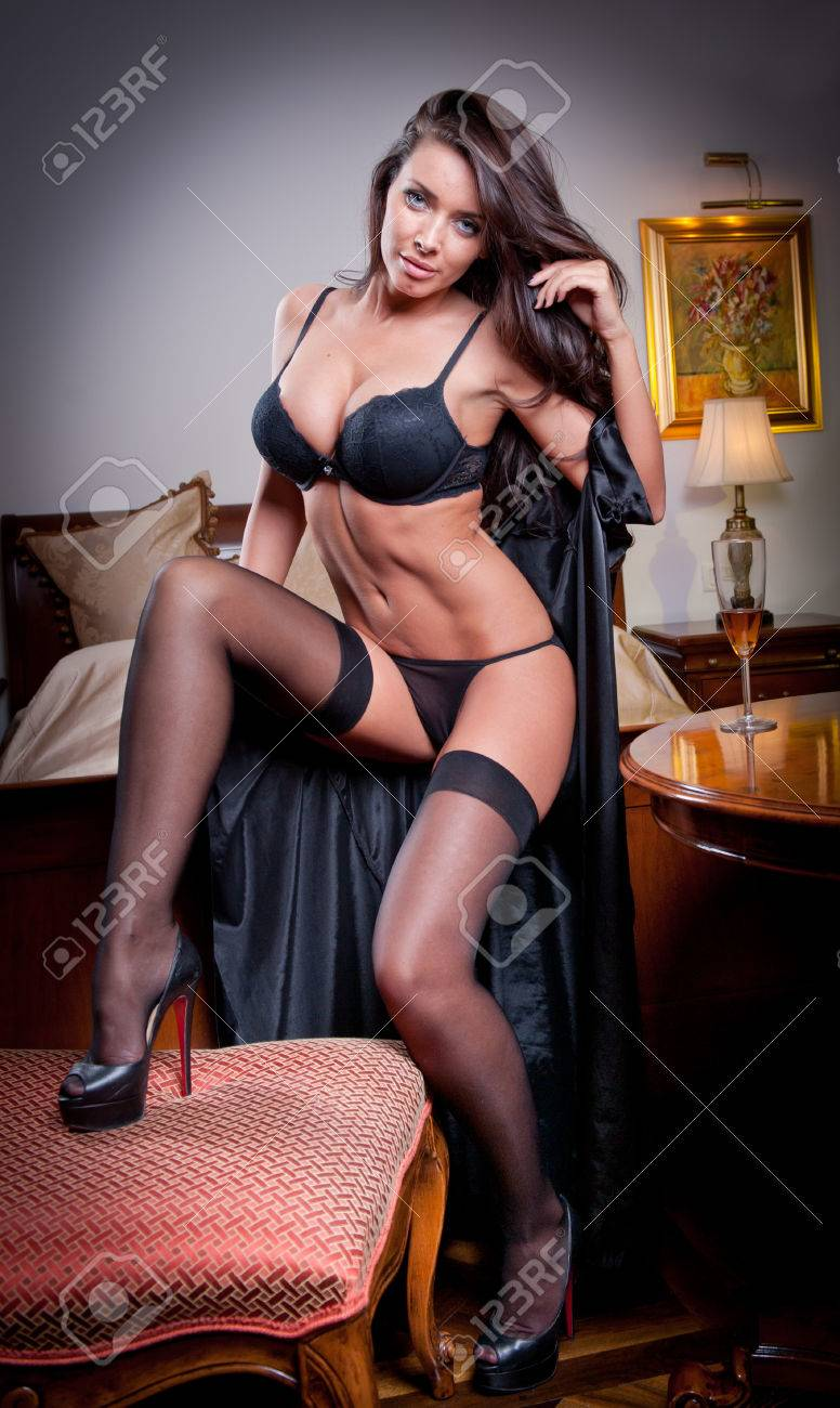 d15669d4354 attractive sexy brunette with black lingerie posing challenging Portrait of sensual  woman wearing black bra in