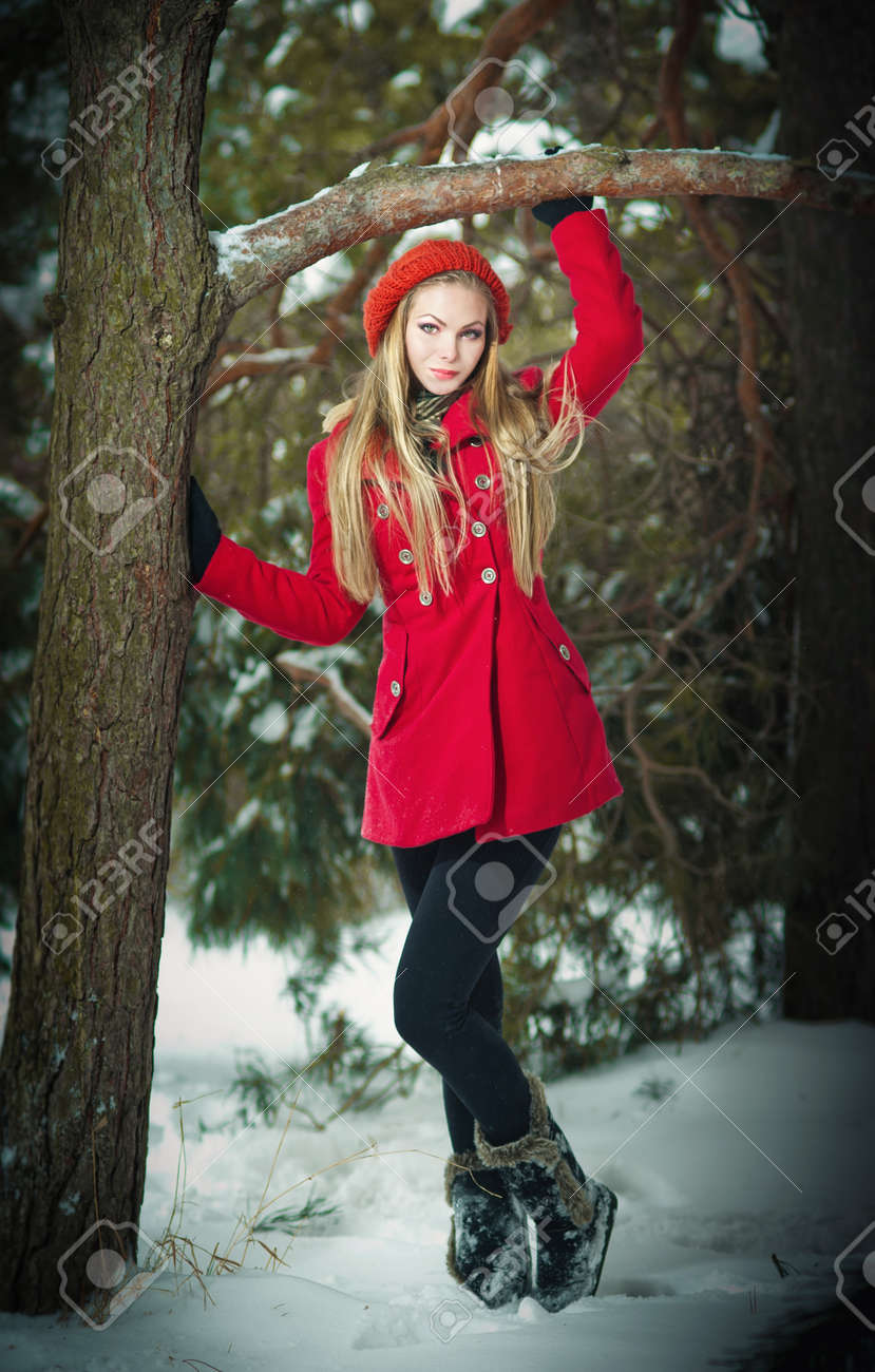 7b8b4a8a5 Attractive Blonde Girl With Gloves And Red Coat Posing Winter ...