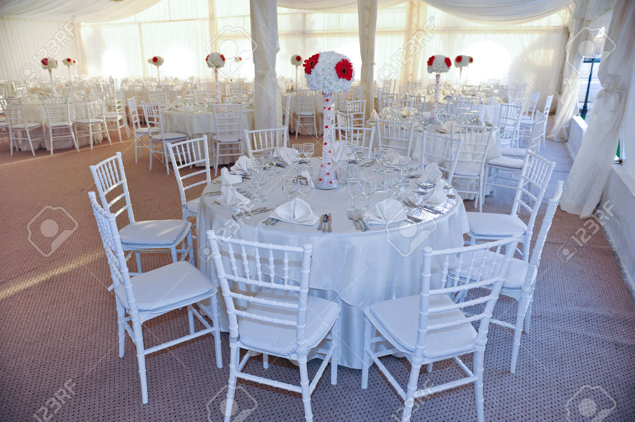 Stock Photo - Wedding tables setting in white color Tables set for an event party or wedding reception Elegant table setting in restaurant White arrangement ... & Wedding Tables Setting In White Color Tables Set For An Event ...