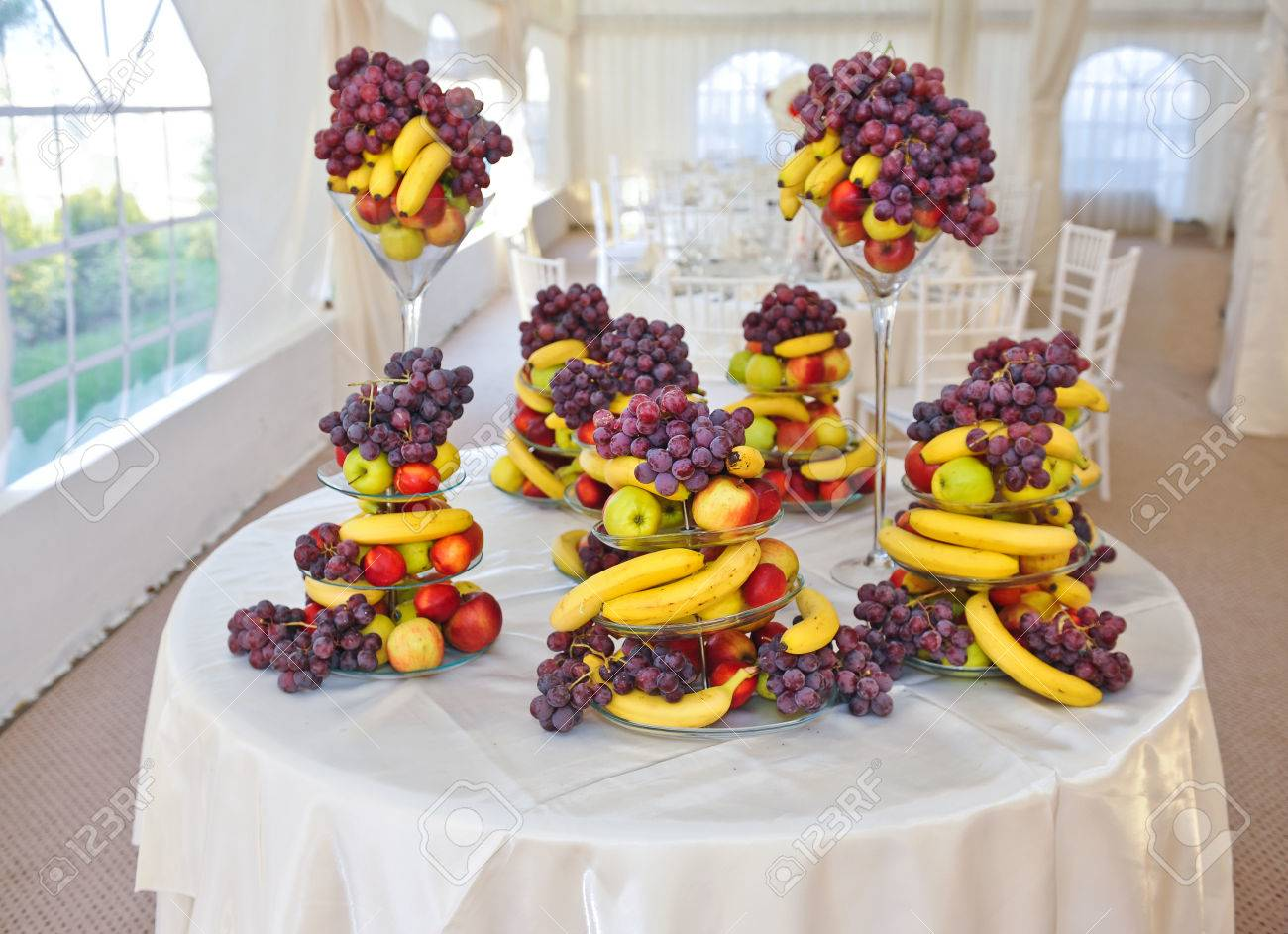 Fruits arrangement on restaurant table wedding decoration with fruits arrangement on restaurant table wedding decoration with fruits bananas grapes and apples stock junglespirit Image collections