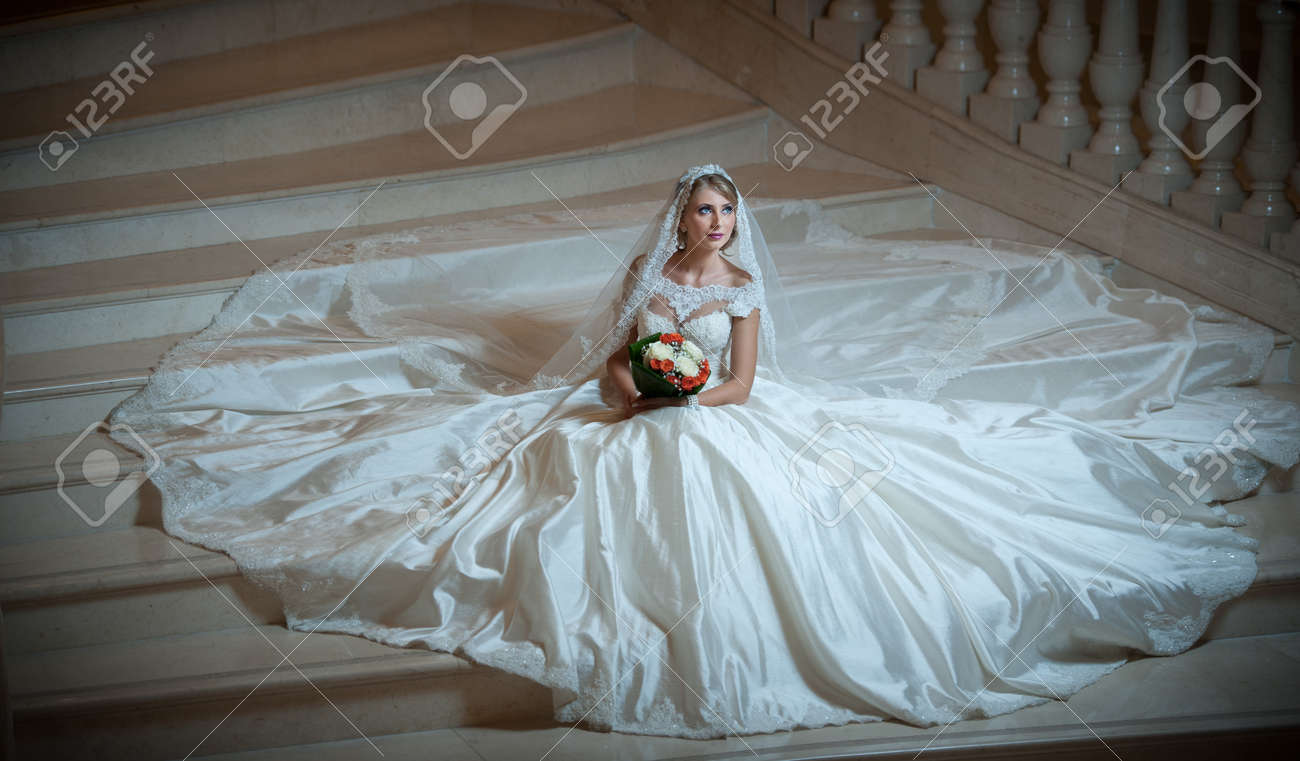 Young Beautiful Luxurious Woman In Wedding Dress Sitting On Stair Stock Photo Picture And Royalty Free Image Image 33147419,Outdoor Wedding Simple Wedding Dresses With Sleeves