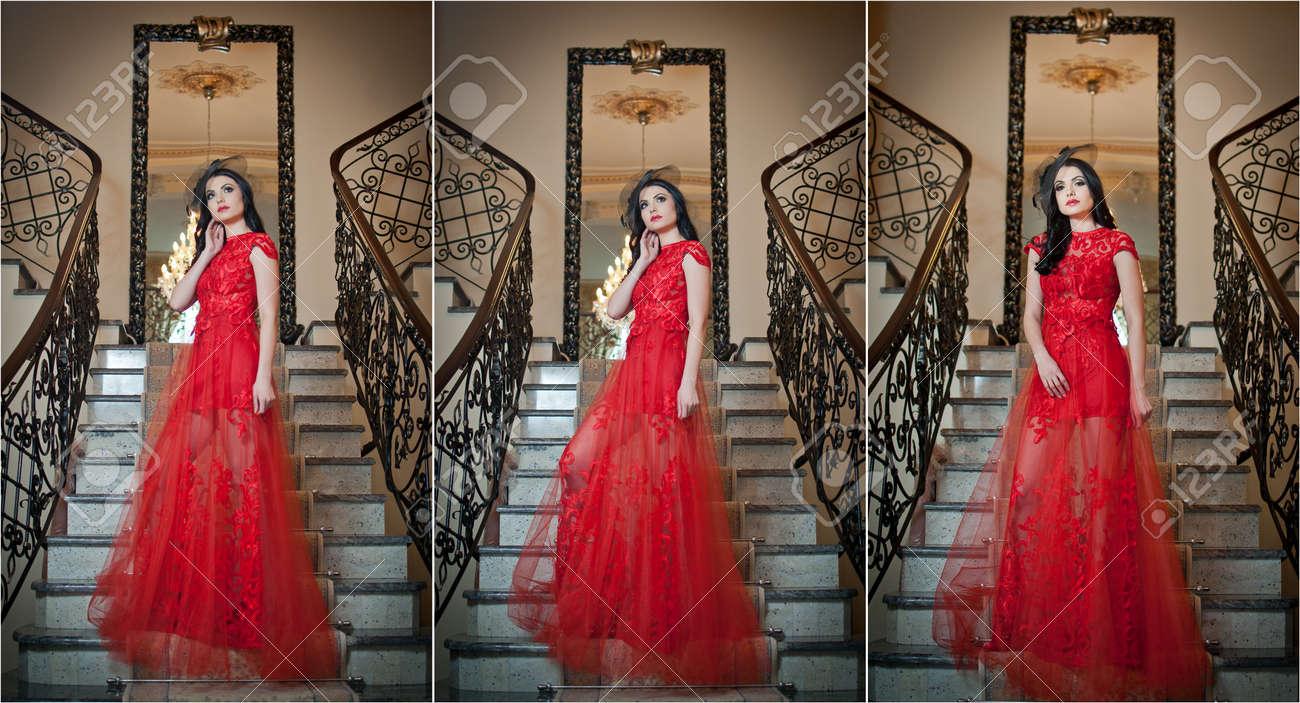 553f0f7a7d6112 Het Mooie Meisje In Een Lange Rode Jurk Poseren In Een Vintage Scène. Jonge  Mooie Vrouw Draagt   een Rode Jurk In Een Oud Hotel.