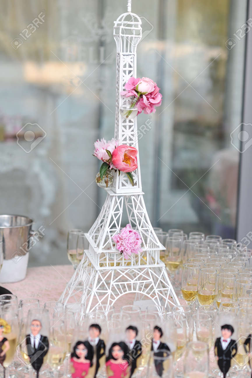 Wedding decoration with pink roses on eiffel tower miniature stock photo wedding decoration with pink roses on eiffel tower miniature elegant and luxurious event arrangement with la tour eiffel and nice glasses junglespirit Choice Image