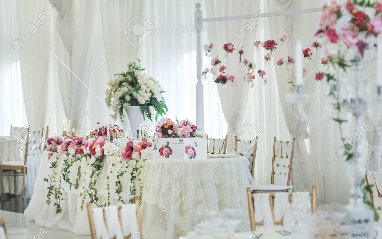 Wedding decoration on table floral arrangements and decoration stock photo wedding decoration on table floral arrangements and decoration arrangement of pink and white flowers in restaurant for luxury wedding event junglespirit Images