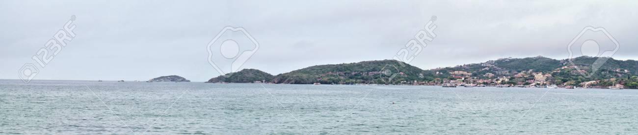 A panorama of the town of Bzios, Brazil. Showing, left to right, Ilha Branca, Praia Azeda, Praia dos Ossos, and Bzios harbour. Stock Photo - 92911503