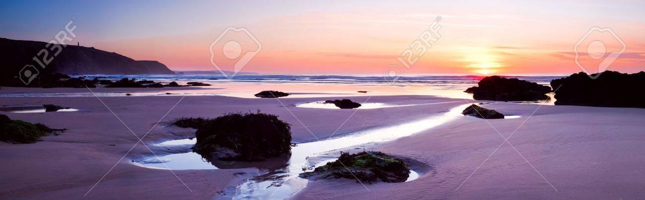 Panoramic shot of sunset on Porthtowan Beach, Cornwall Stock Photo - 14400724