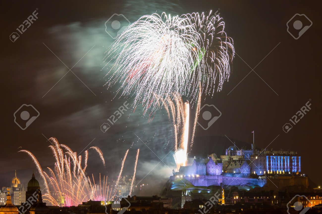 Spectacular Hogmanay (New Years Eve) fireworks over Edinburgh Castle, Scotland UK Europe Stock Photo - 25481786