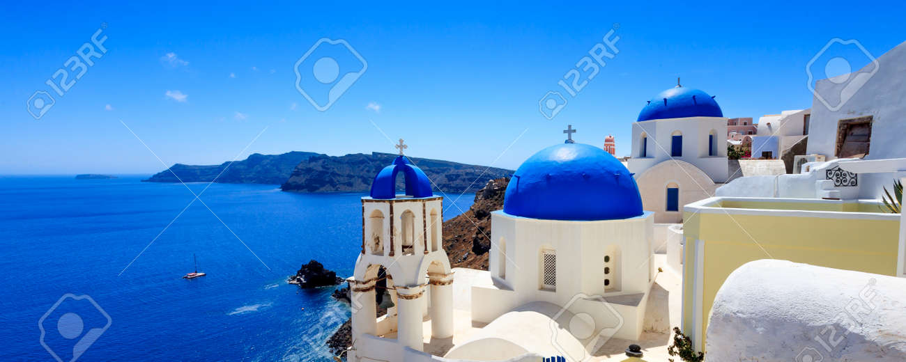 Panoramic shot of the Blue domed church at Oia Santorini Greece Europe Stock Photo - 27262659