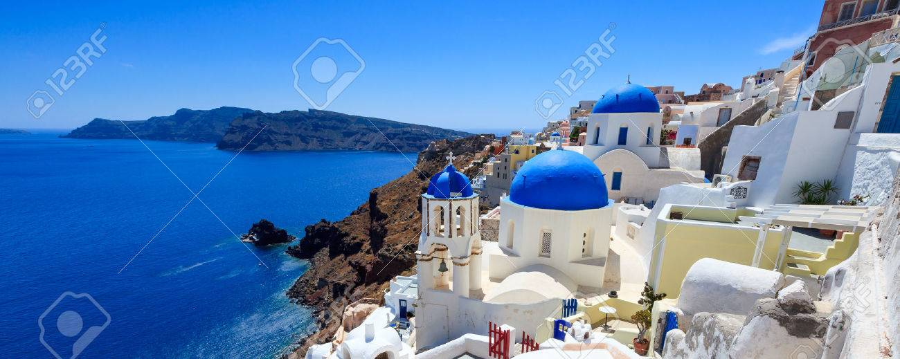 Panoramic shot of the Blue domed church at Oia Santorini Greece Europe Stock Photo - 27262660