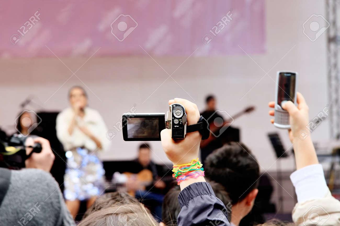 ISTANBUL - APRIL 23: Crowd of music fan record the show during Bengu Erden Concert at Marmara Egitim Kurumlari on April 23, 2011 in Istanbul, Turkey. - 9420062