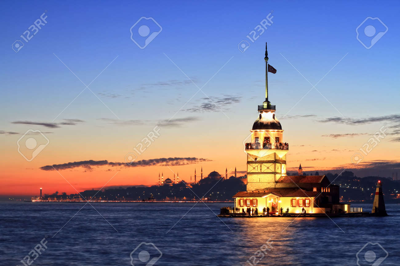 Istanbul Maiden Tower from the east in sunset. In the distance are such landmarks as Blue Mosque, Hagia Sophia and Topkapi Palace - 9531630