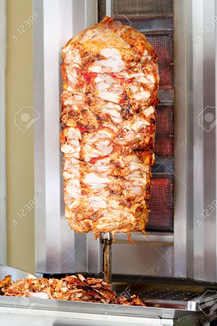 Kebab, meat roasted on large vertical spit - 9806126