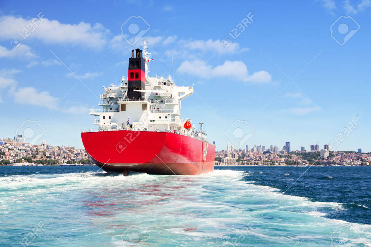 Red cargo ship sailing in to the sea - 13067818