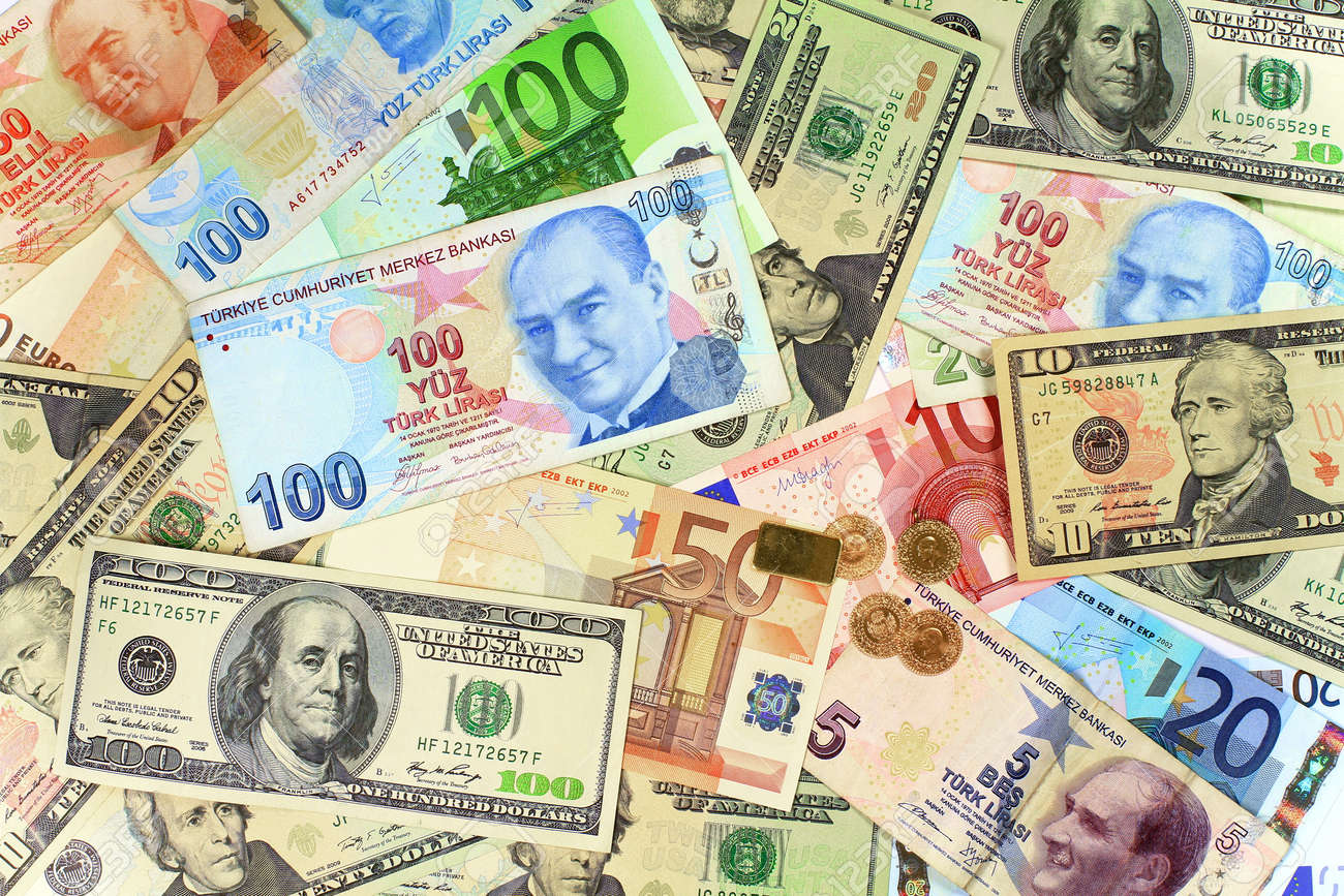 One hundred Turkish Lira banknote on other currencies Background from dollars and euro bills - 25042431