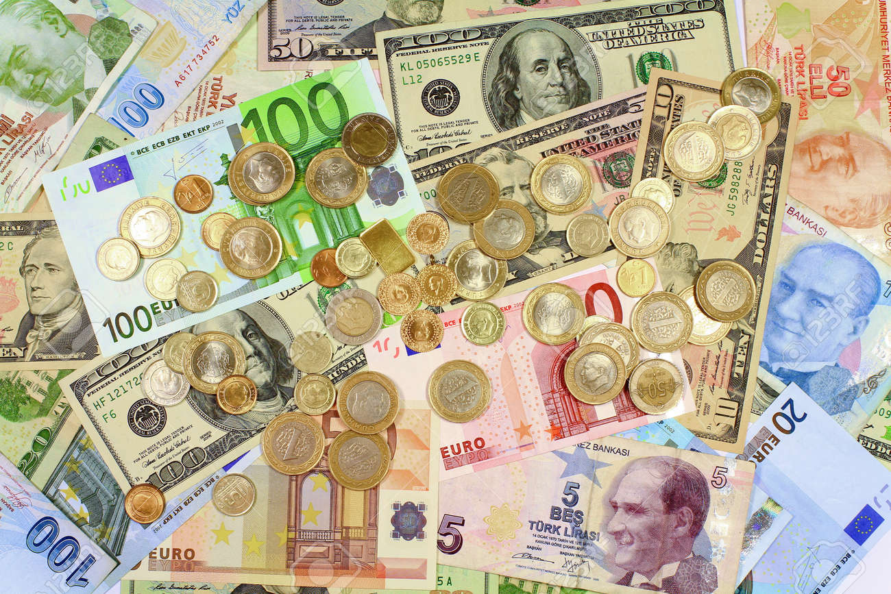 Background from dollars and euro bills Coins on paper bills as background - 25042434
