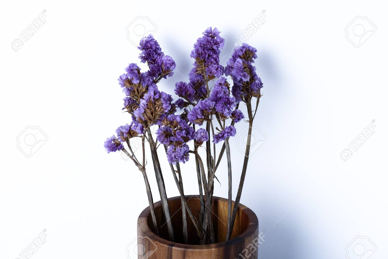 Wood Vase Classic With A Bouquet Of Purple Flowers On White