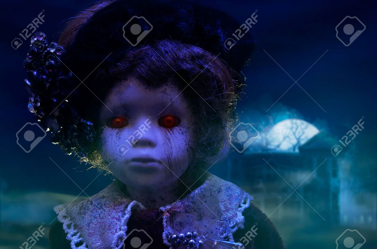 Horror doll with haunted house old mystical scary horror doll looking with red demonic eyes