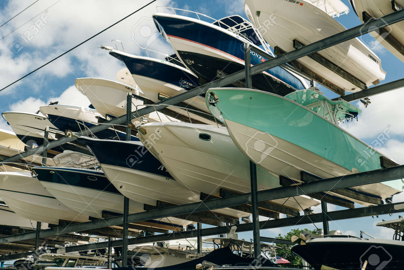 speed motor boats are stapled in a garage system in the prestigious harbor in Miami. - 150715674