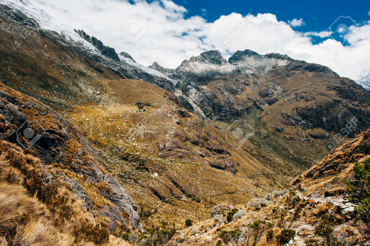 The view from the valley on the hiking path to Laguna 69, Peru - 169711485