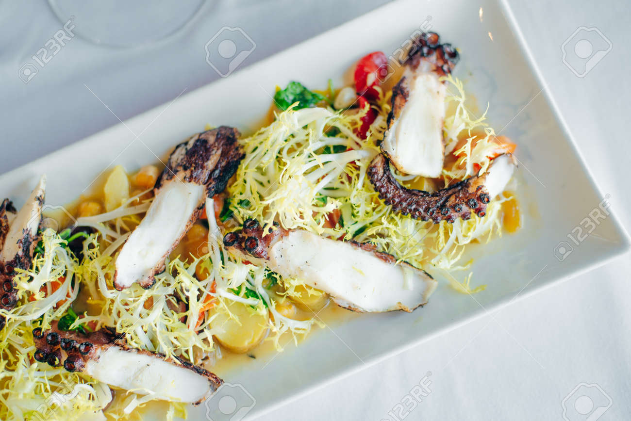 octopus with vegetables and salad in restaurant. - 169532641