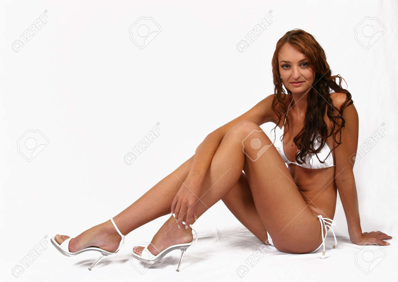 Woman sitting in bikini with shoes on Stock Photo - 294798
