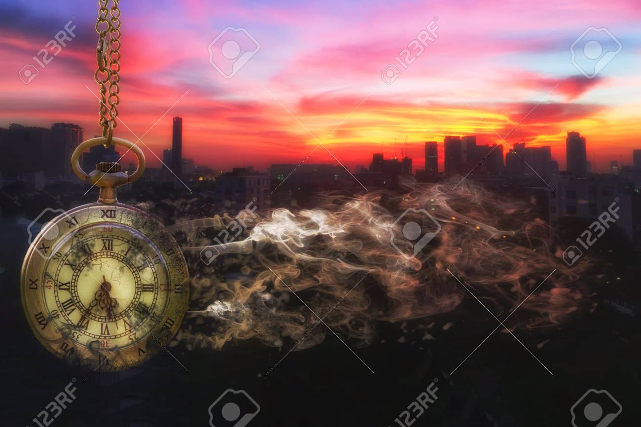Pocket watch is disintegrating with city scape background at last sunlight (Concept of wasting time) - 69567949