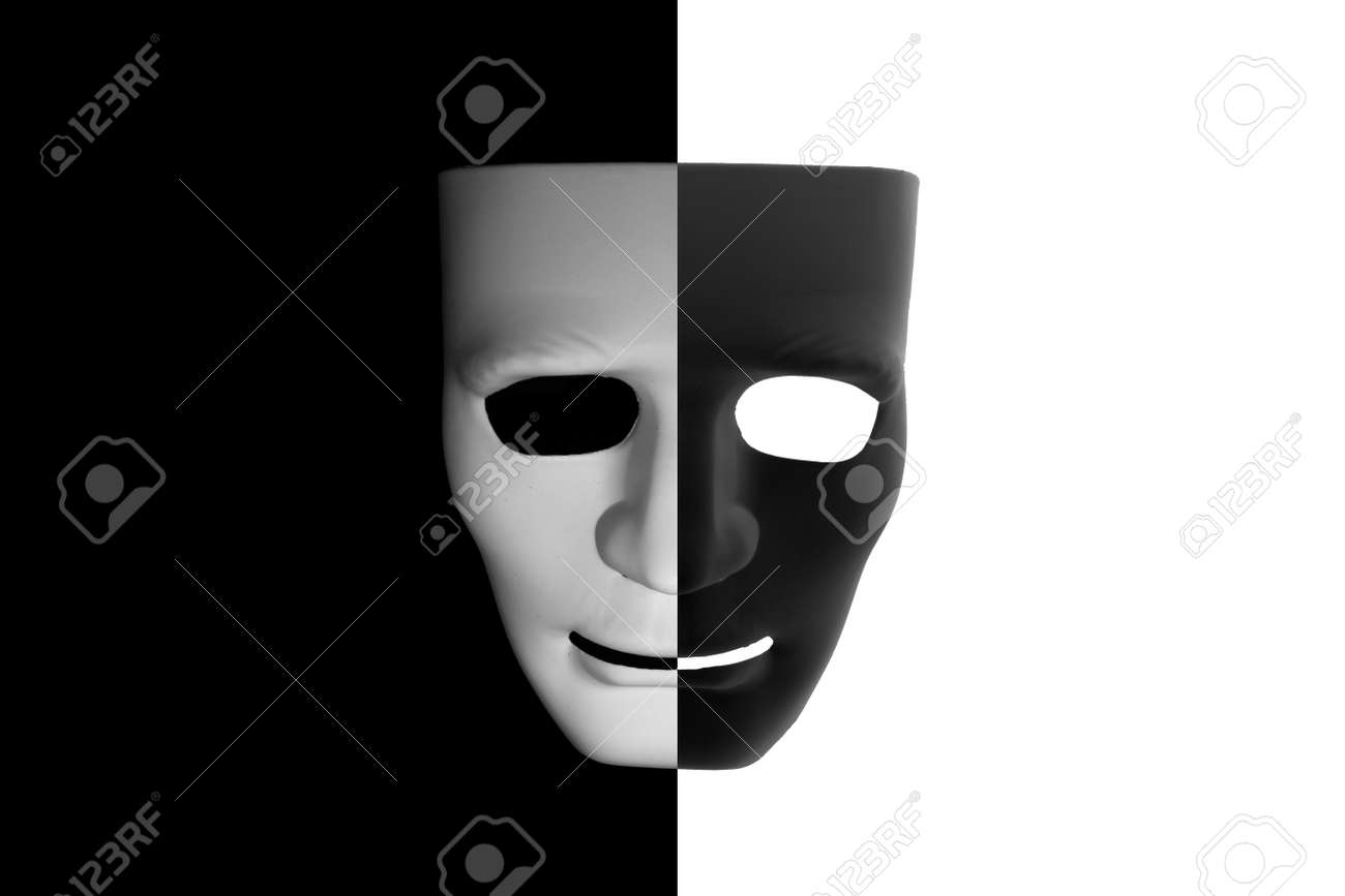 Black and white mask half half on contrast background stock photo 83405591