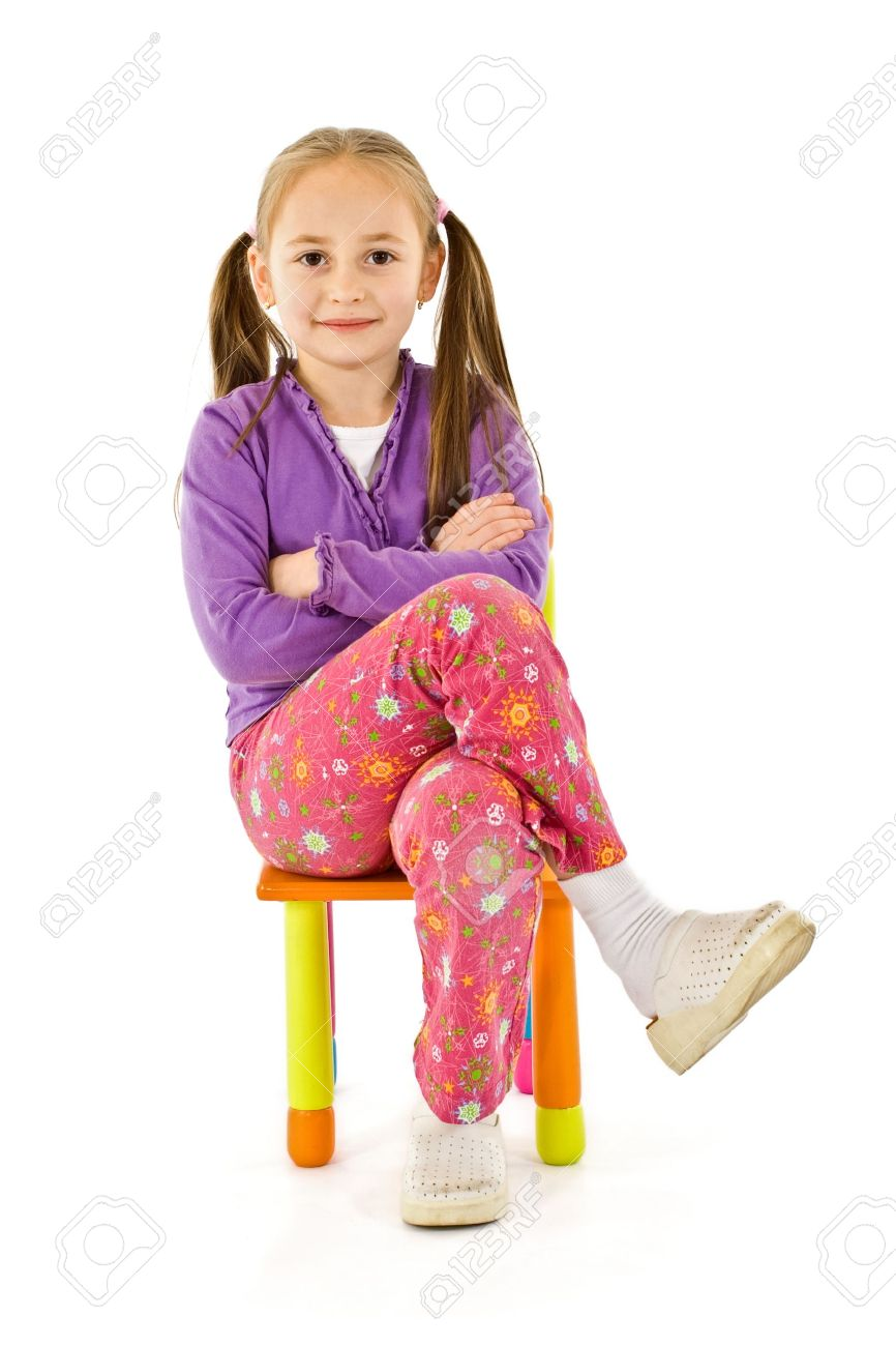 Smiling Little Girl Sitting On A Small Chair Stock Photo Picture
