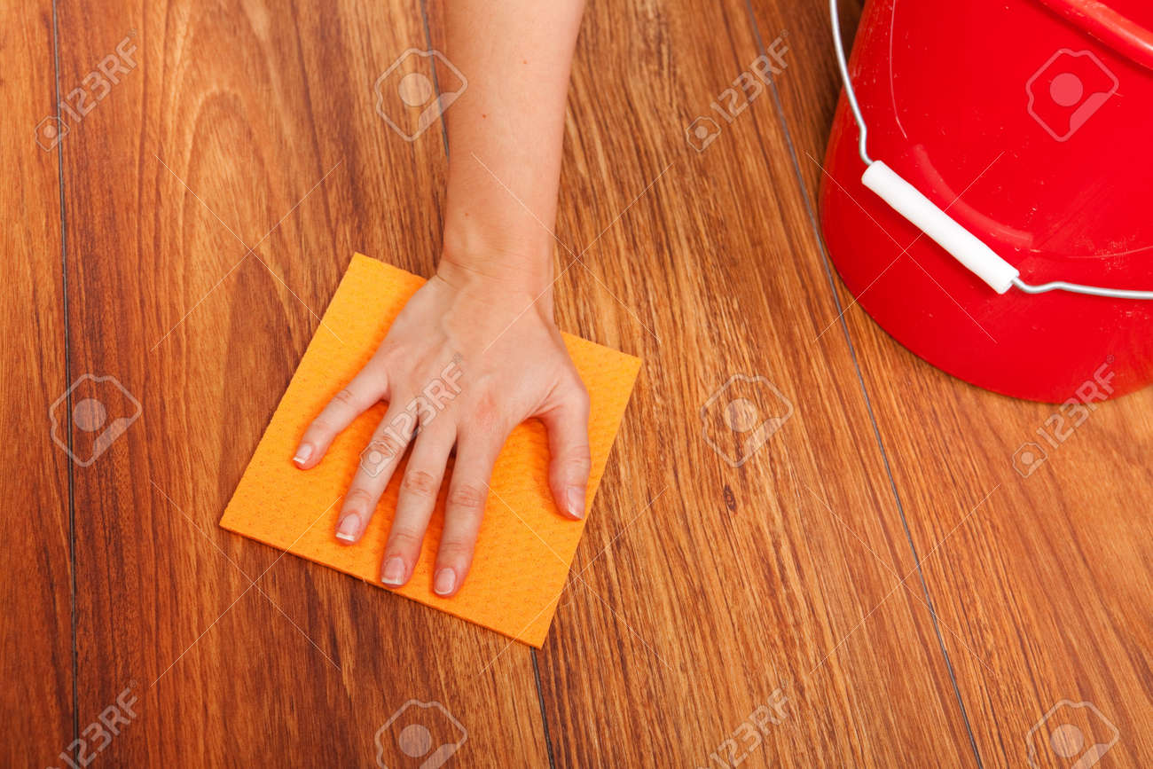 Woman's hand cleaning the floor with yellow sponge Stock Photo - 6824321