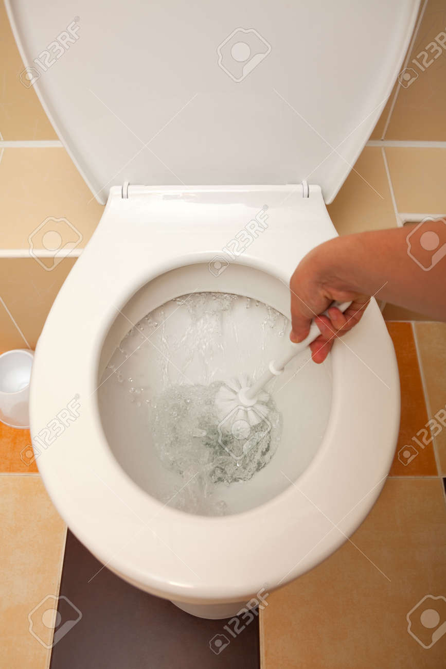 Hand Washing The Open Toilet With Brush Stock Photo, Picture And ...