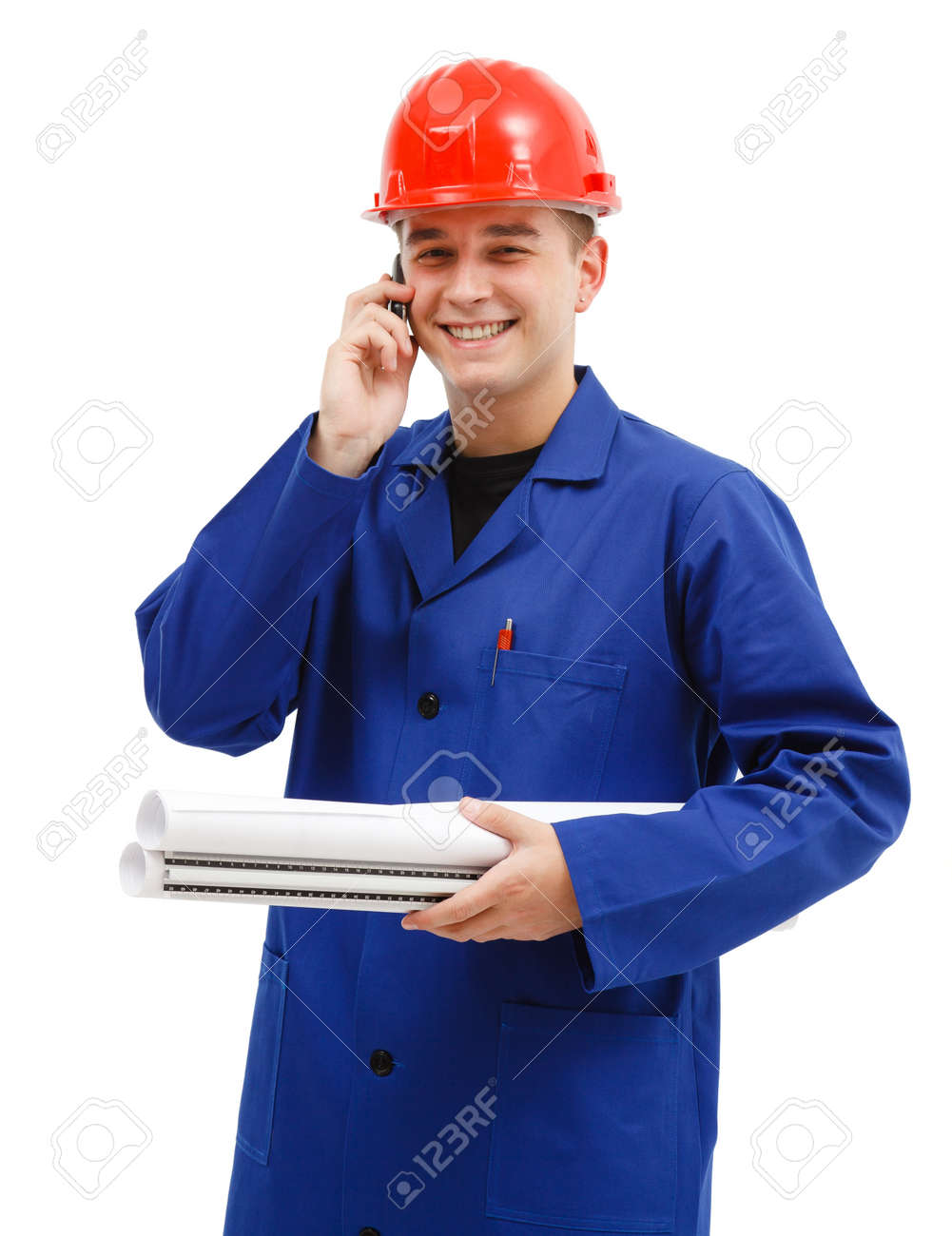 Happy engineer with red helmet holding layout plans talking on the phone Stock Photo - 10658837