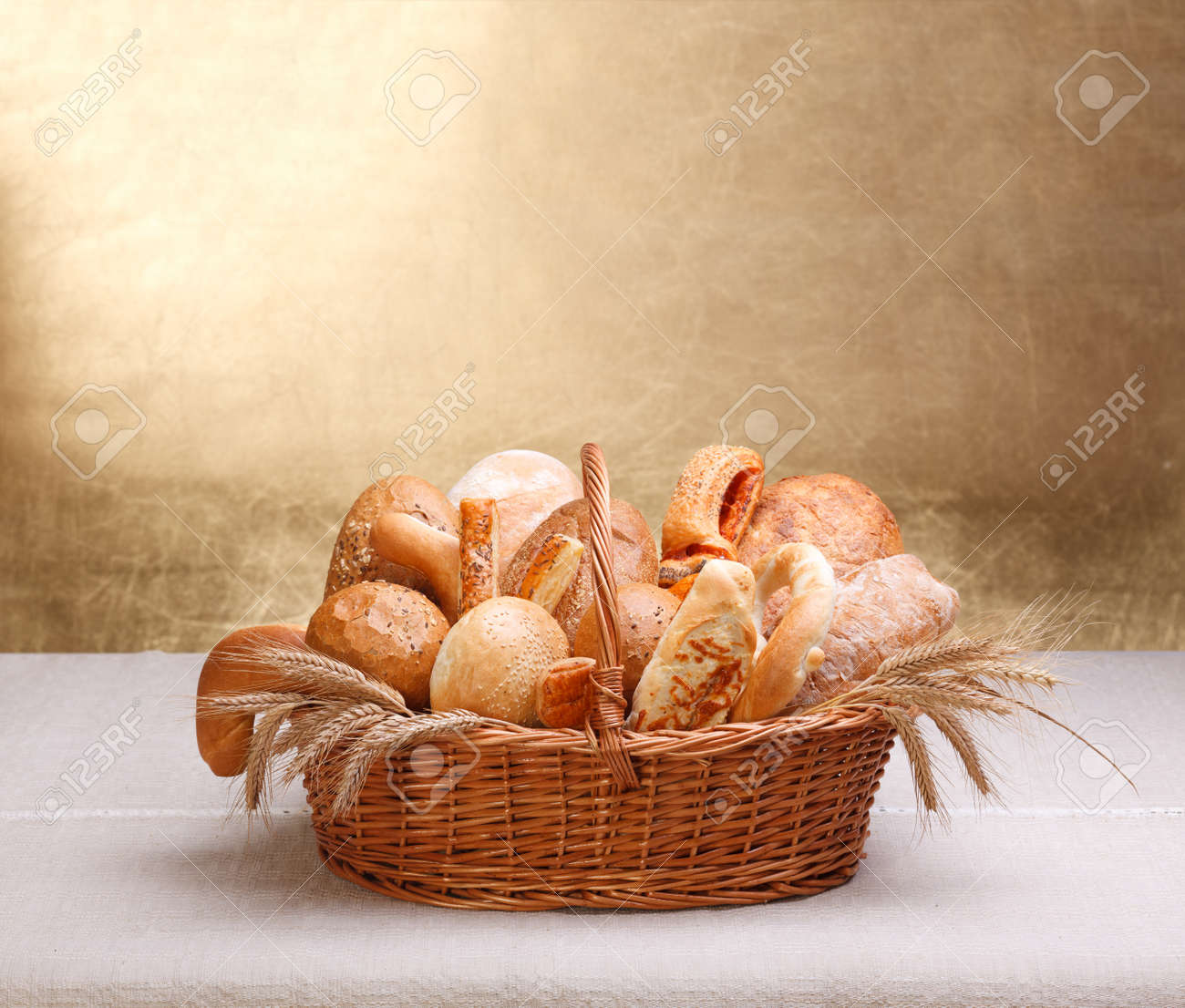 Lots of assorted bakery products in basket, big copy space on top - 14831762