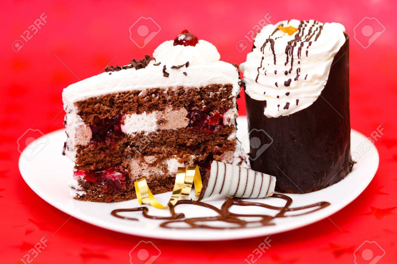 Two slice chocolate fancy cake on red background Stock Photo - 15027969