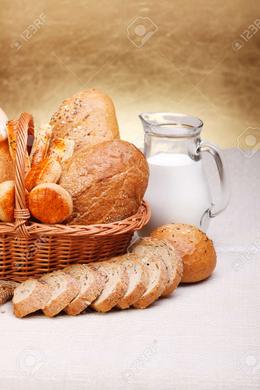 Assorted bread products with milk in jug on canvas Stock Photo - 15027974