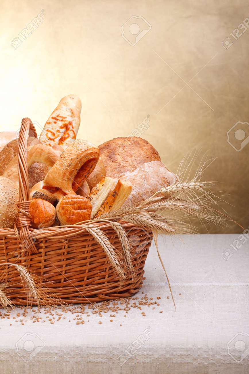 Variety of baked products in basket. Copy space above - 15027970