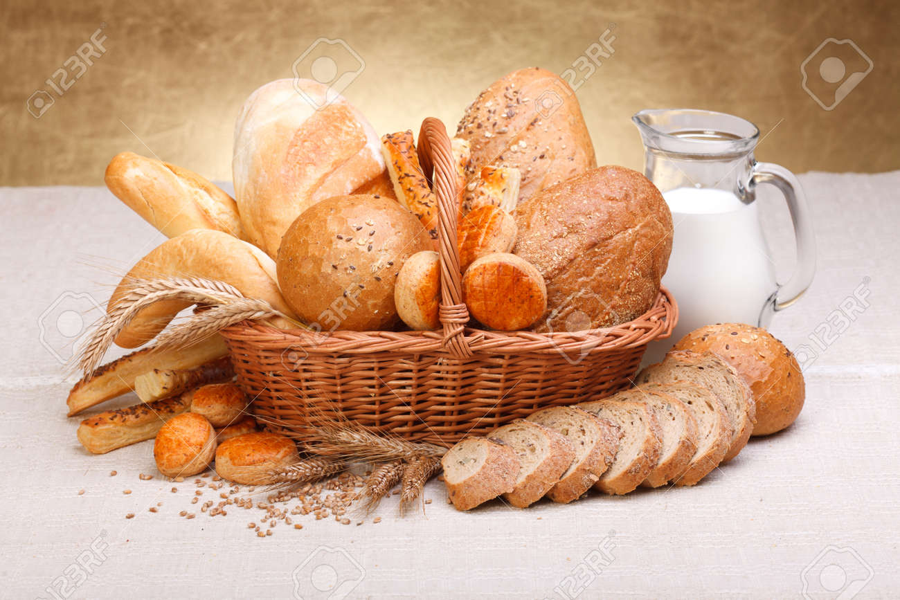 Different bread products with milk in jug on canvas Stock Photo - 16059597
