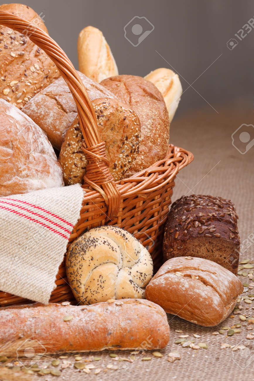 Various breads in basket on canvas tablecloth Stock Photo - 16059604