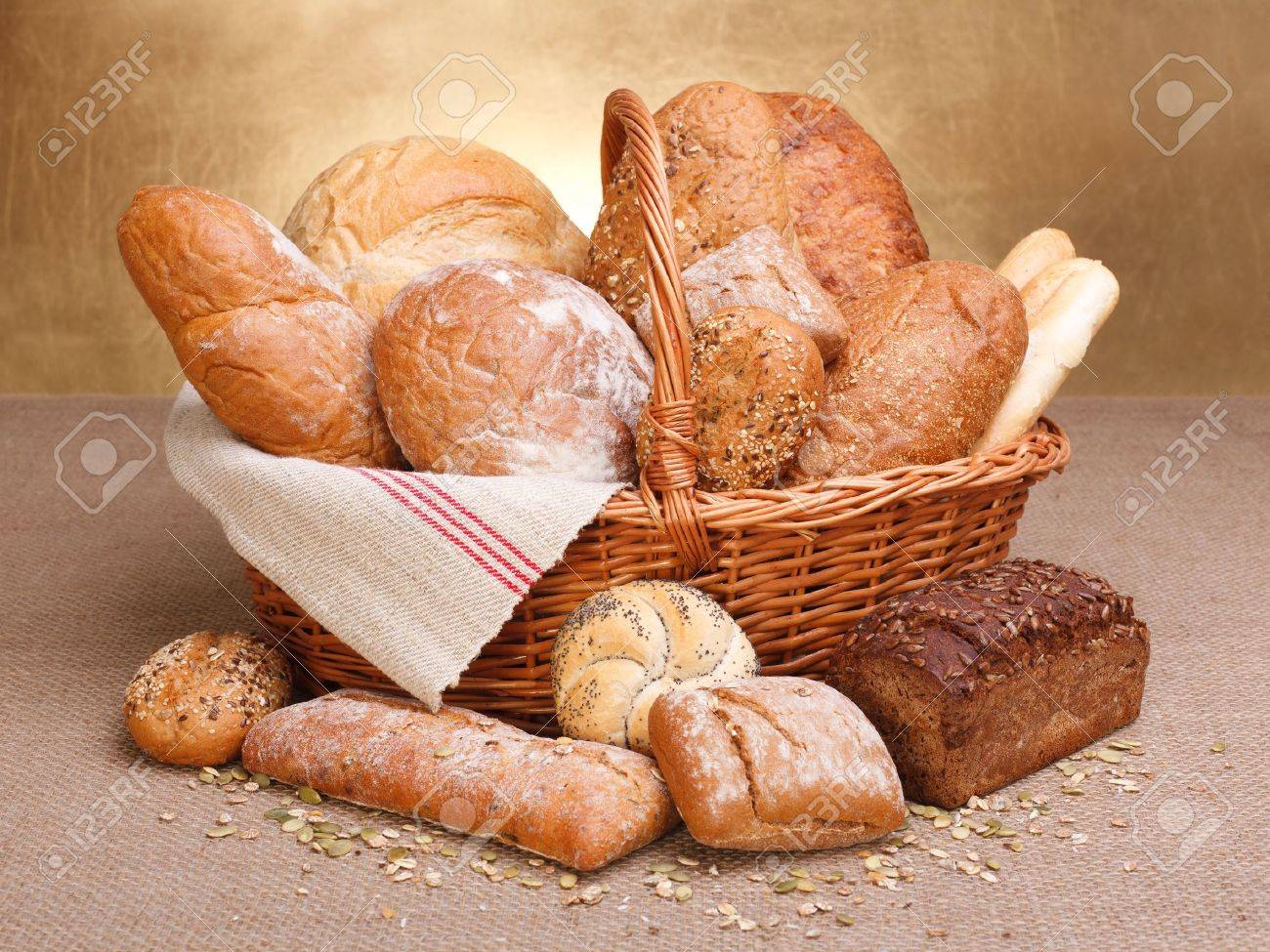 Various breads in basket on canvas tablecloth - 16059613