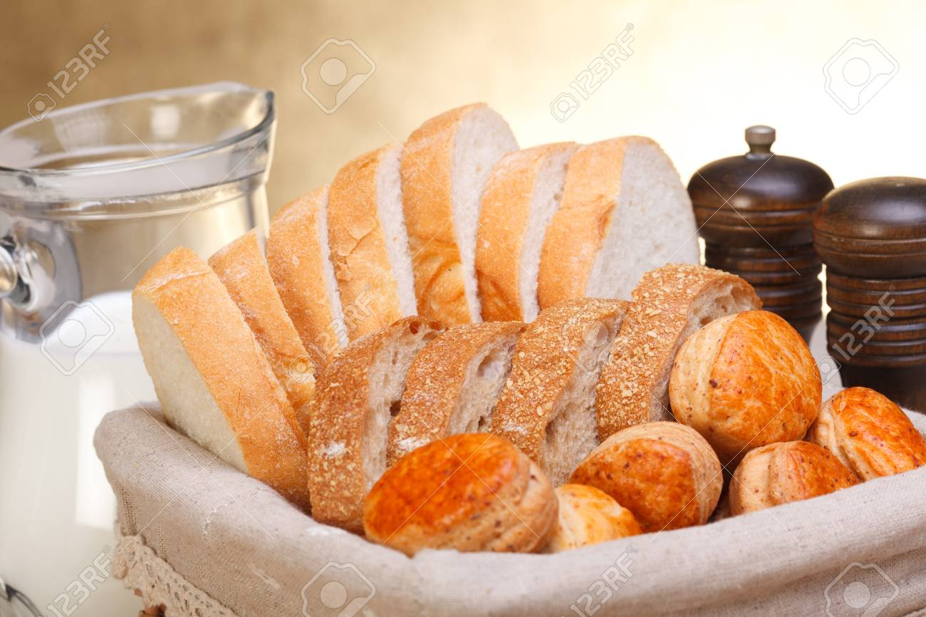 Assorted bakery products sliced, arranged in small basket. Stock Photo - 16059577
