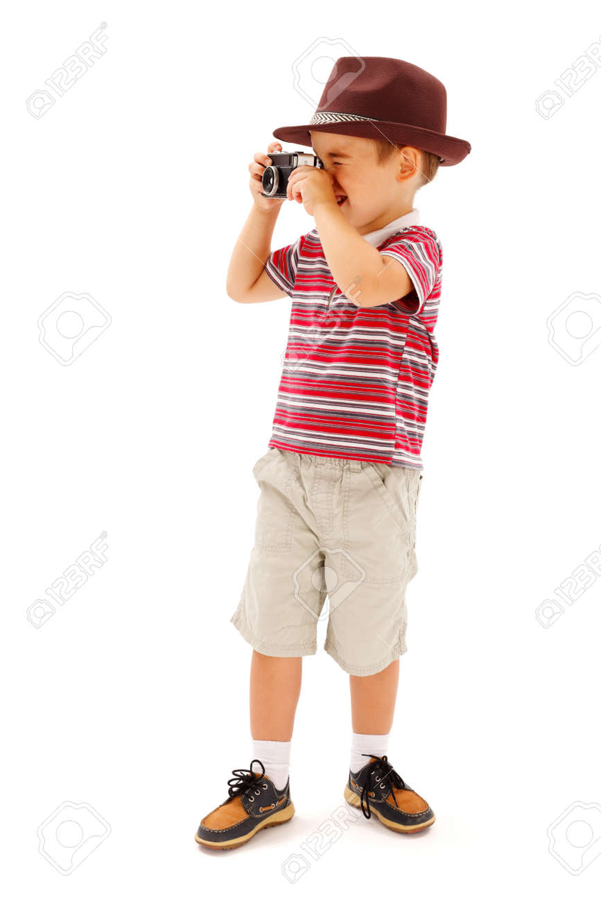 Little boy in hat, taking photos with an old fashioned camera - 22163032
