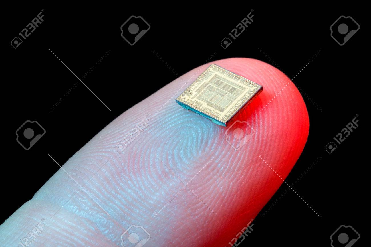 Silicon micro chip on human finger's tip - 35631152