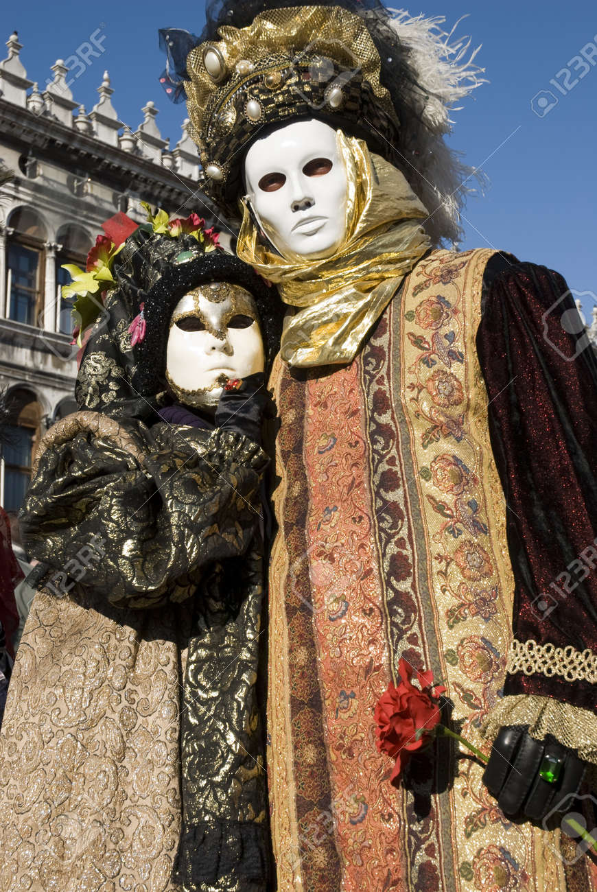 Traditionally dressed Venice carnival couples in Piazza San Marco, Italy Stock Photo - 4373238