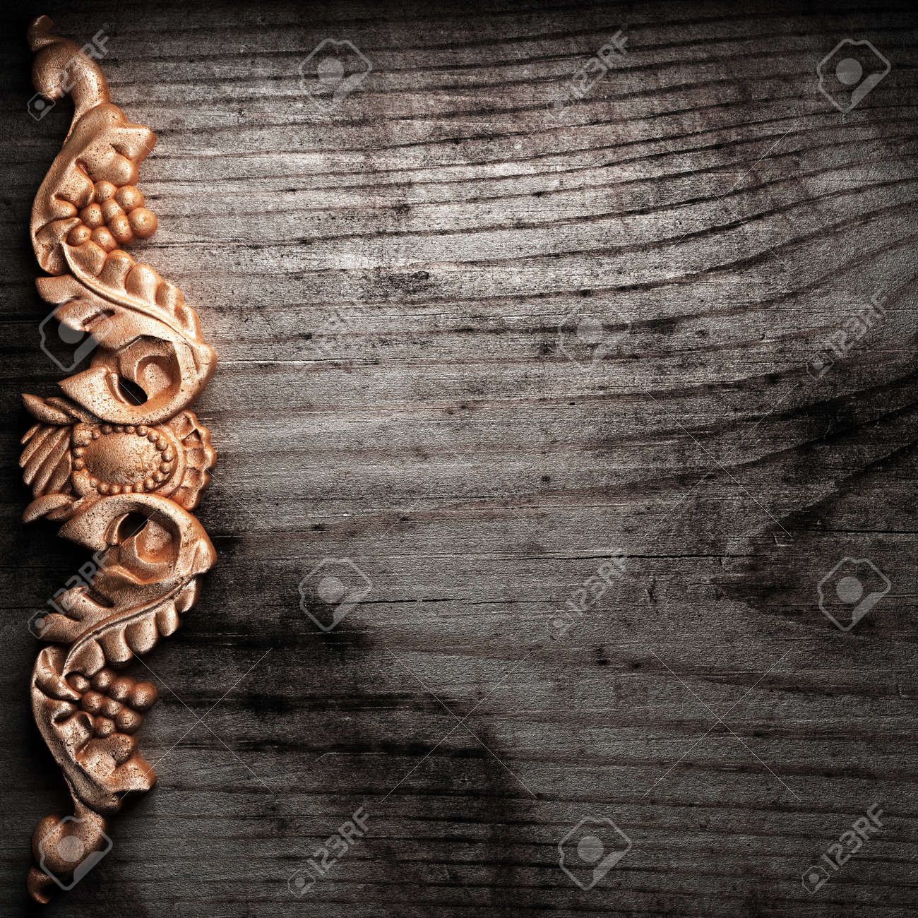 golden ornament on wood made in 3D Stock Photo - 7774908