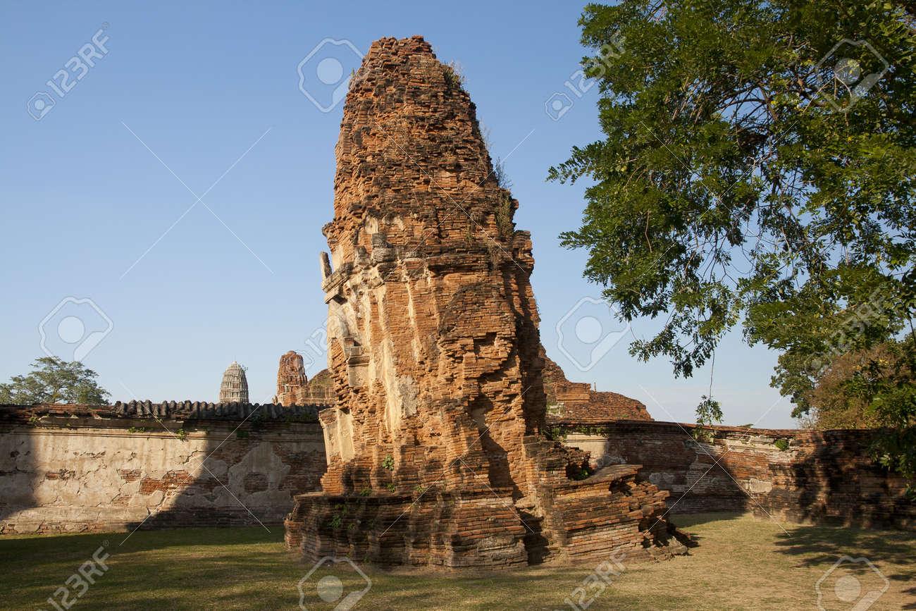 Ages pagoda at historical park, Ayutthaya, Thailand. This ruined pagoda was built around 400 years ago in the Ayutthaya kingdom period. Stock Photo - 17207895