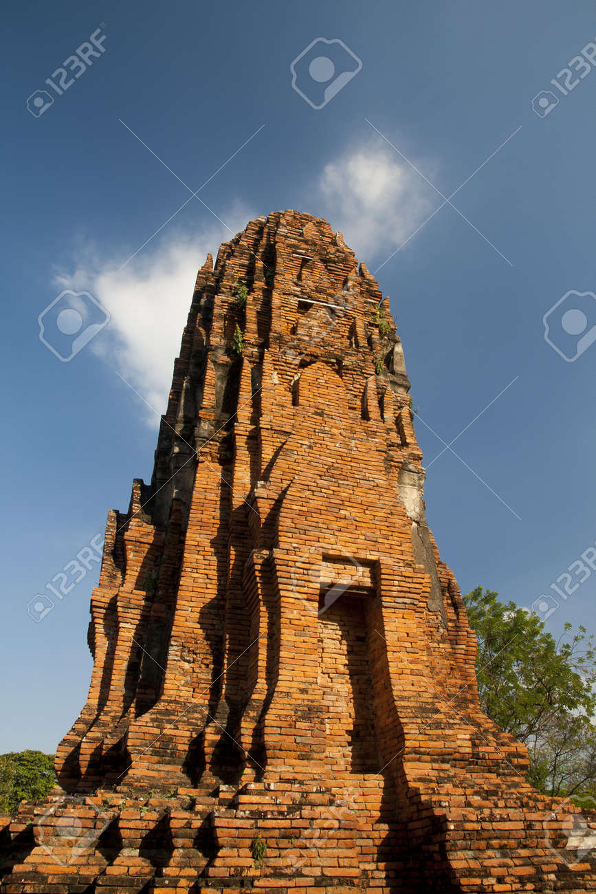 Ages pagoda at historical park, Ayutthaya, Thailand. This ruined pagoda was built around 400 years ago in the Ayutthaya kingdom period. Stock Photo - 17207891