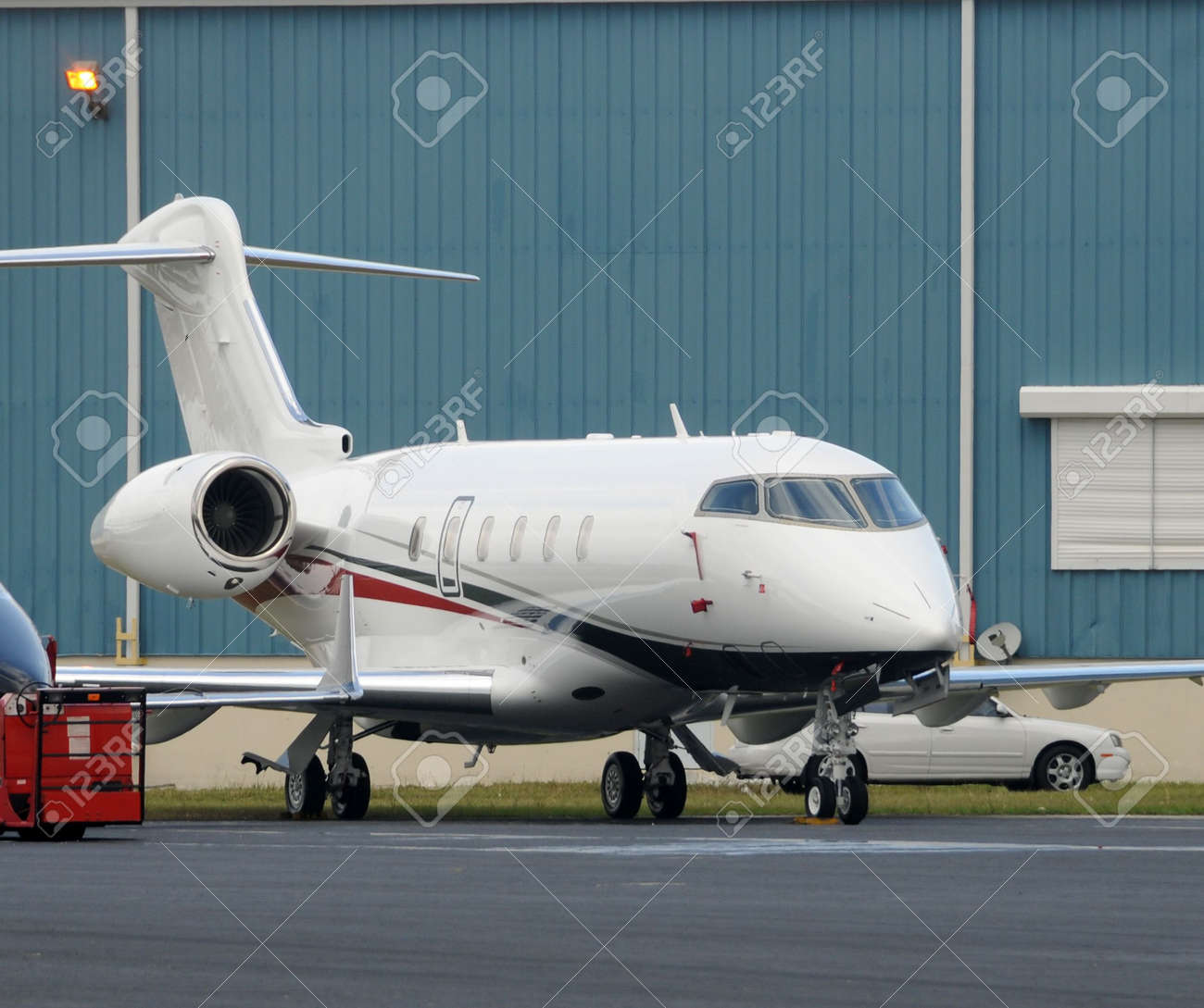Luxury private jet parked near airport hangar Stock Photo - 6523721
