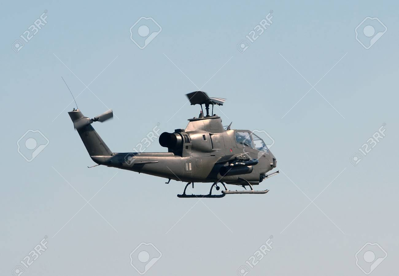 Vietnam War era military attack helicopter in flight