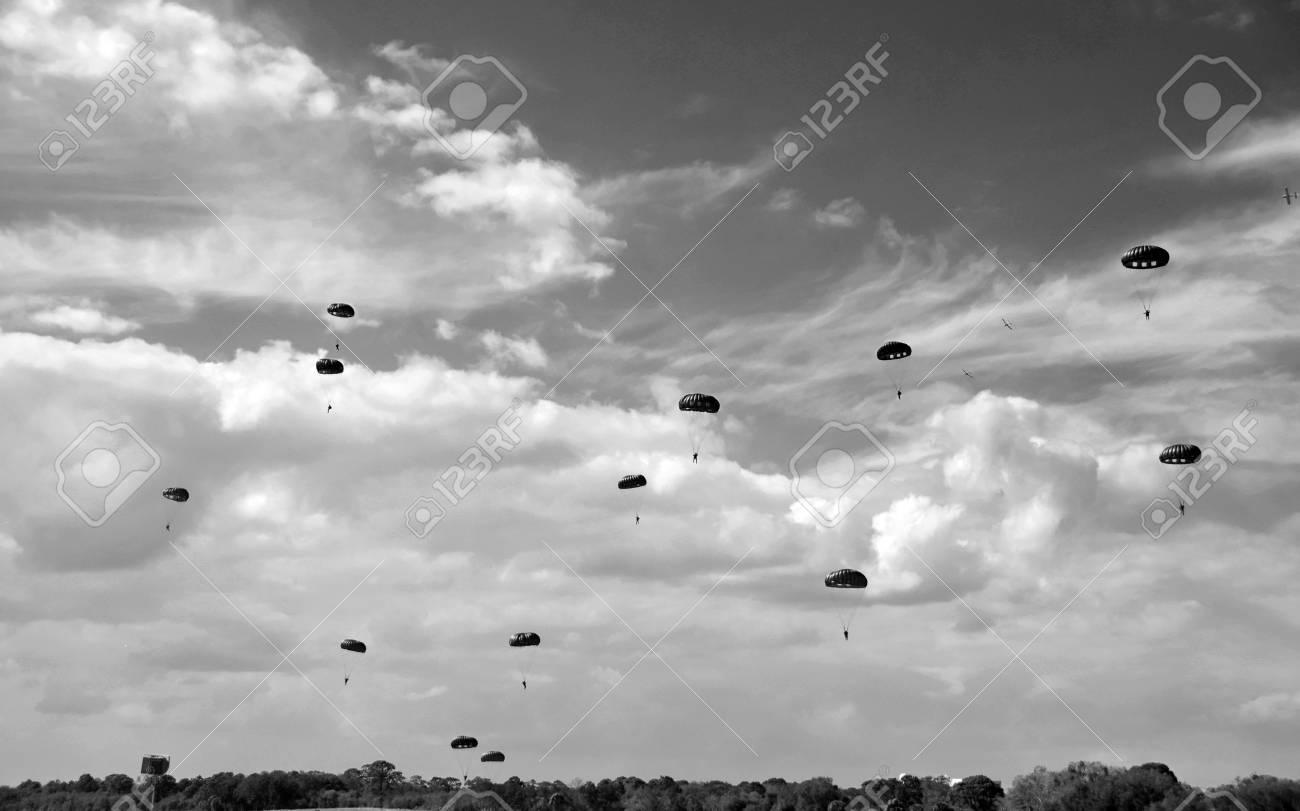 Stock photo world war ii era parachute drop in black and white